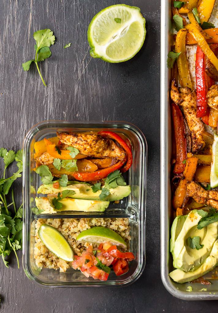 glass meal prep container filled with chicken fajitas ingredients, cauliflower rice and limes