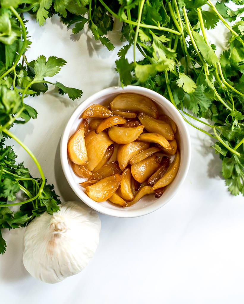 Add a punch of flavor to your favorite Summer grilling recipes with this RoastedGarlic Cilantro Chimichurri Sauce! This bright green cilantro chimichurri recipe is fantastic on burgers, chicken, steaks and more. And this is a Whole30 Paleo compliant recipe, gluten free, grain free, vegan and dairy free. #whole30recipes #paleodiet #chimichurri #cilantro