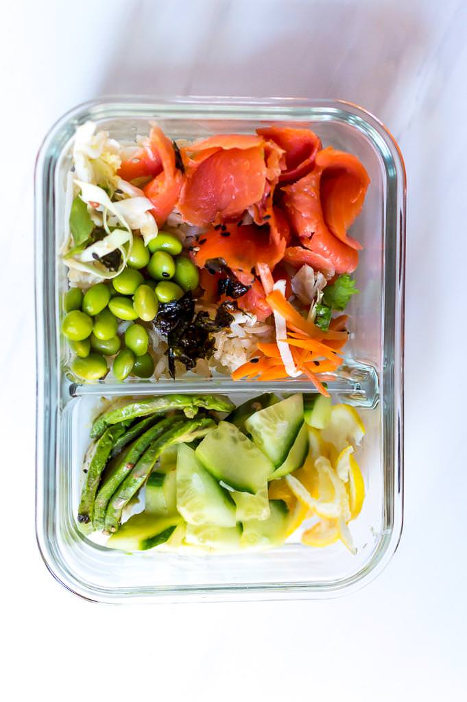salmon sushi roll bowl ingredients in a glass meal prep container
