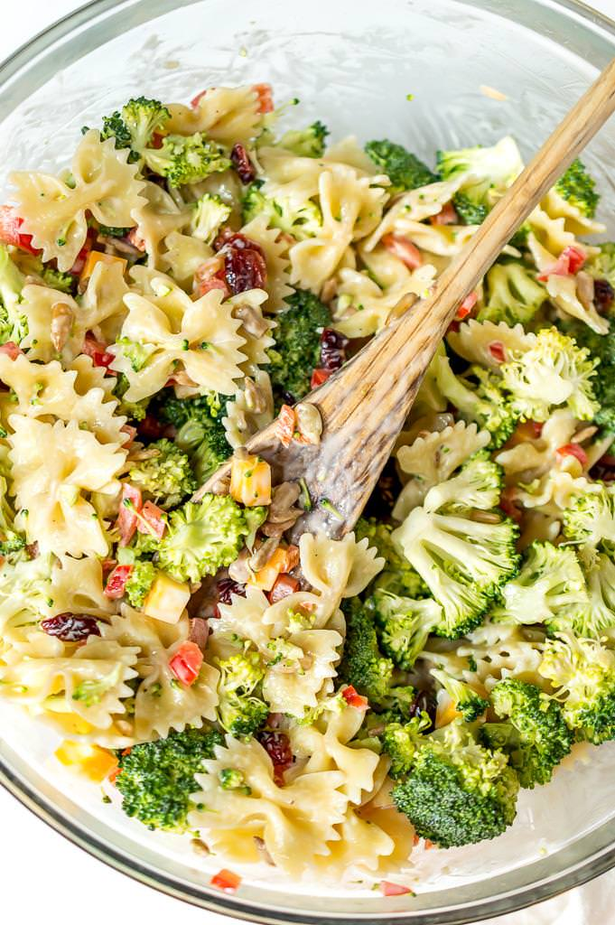 glass bowl and wooden spoon with broccoli salad recipe