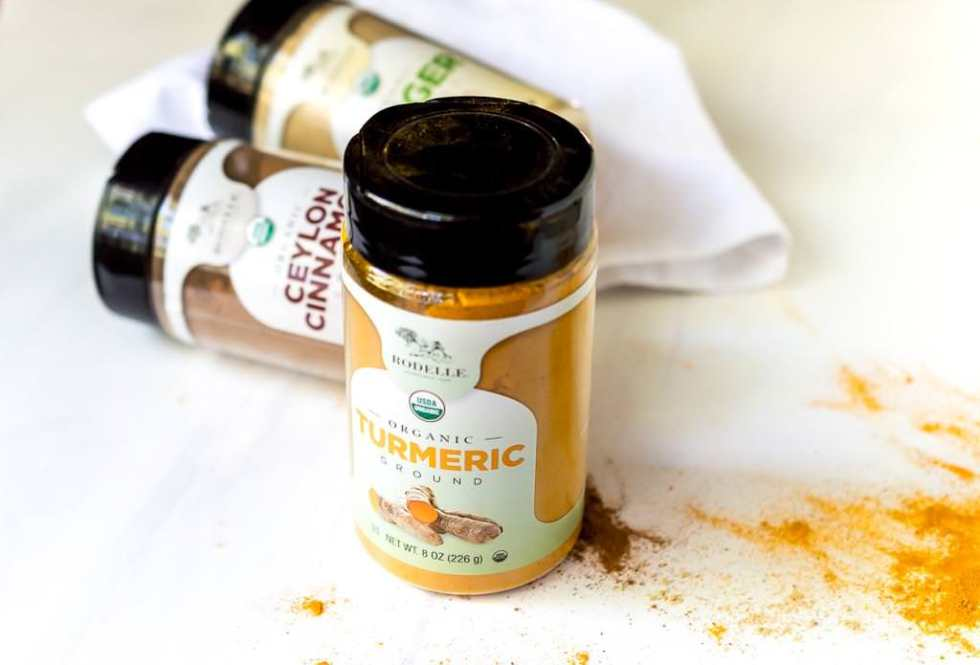 photo of golden milk spices, turmeric, cinnamon, ginger