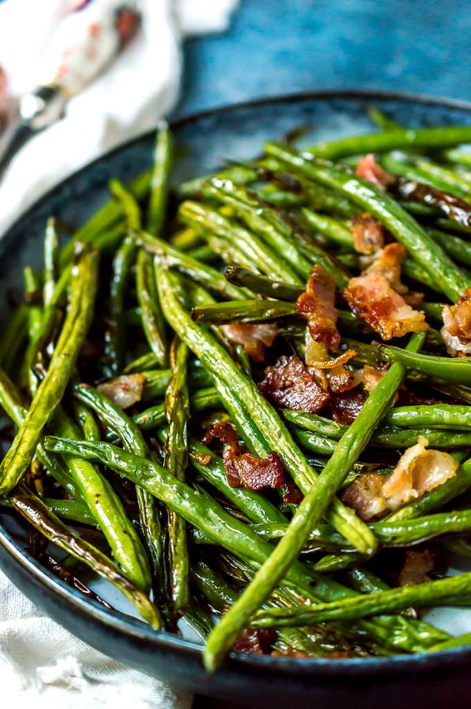 close up photo os roasted green beans with bacon