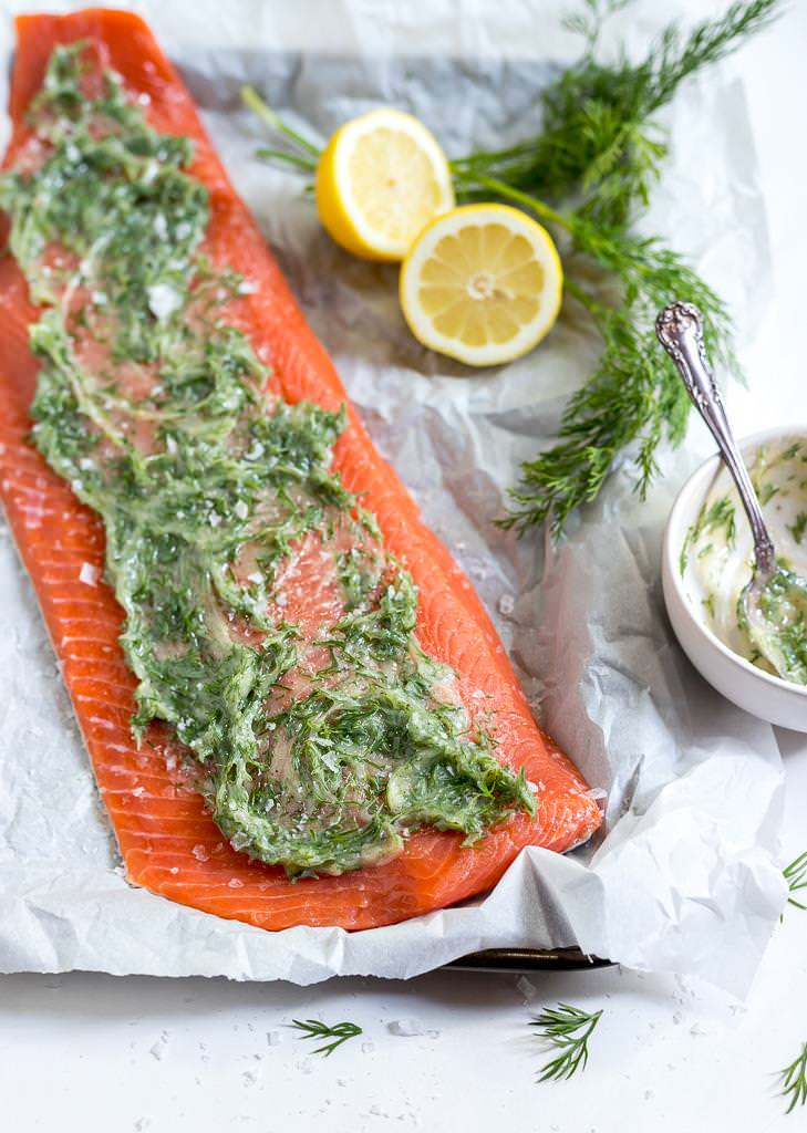 raw salmon fillet topped with ghee and dill mixture