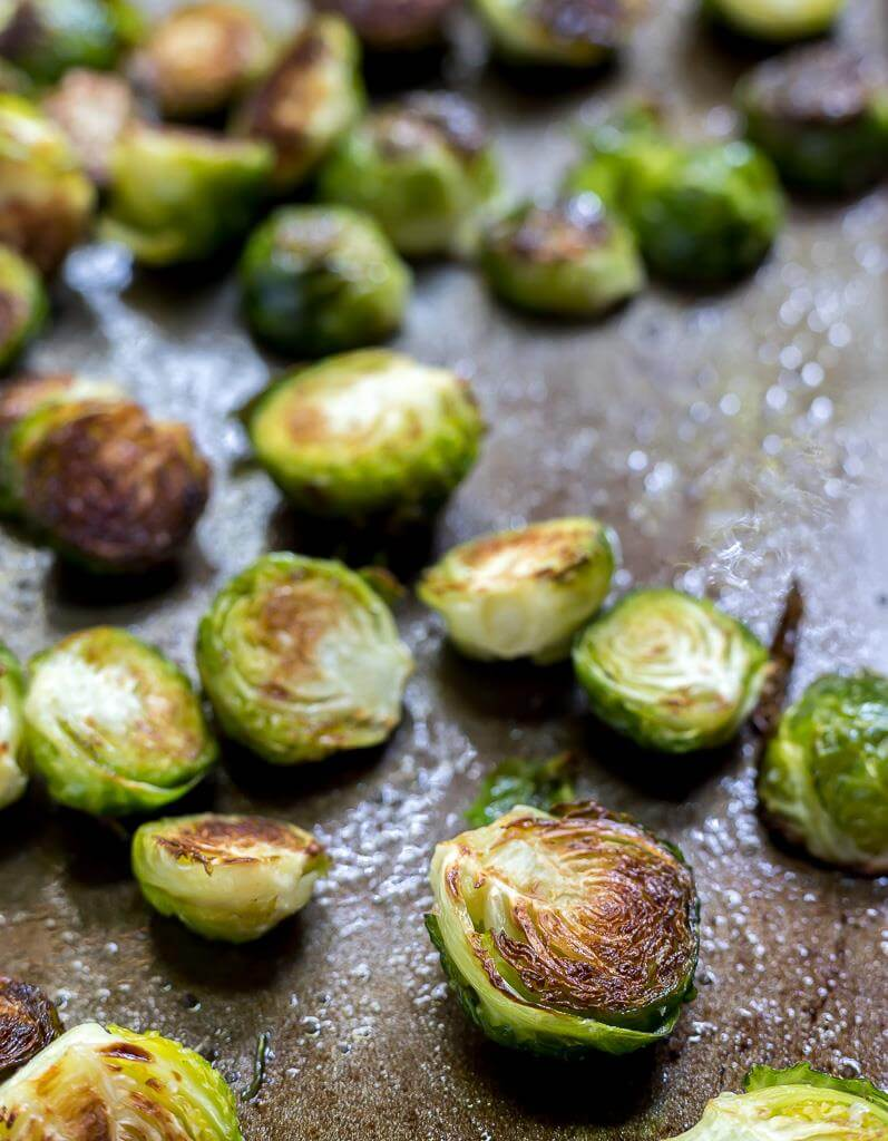 roasted brussels sprouts on baking sheet