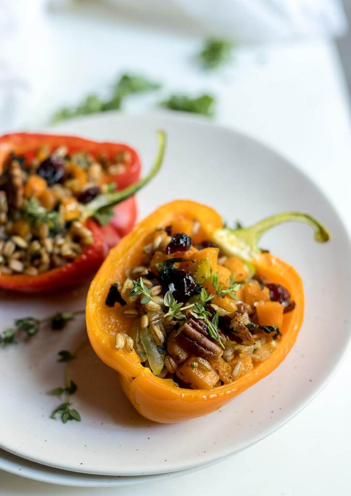faro salad stuffed peppers recipe on white plate with white background