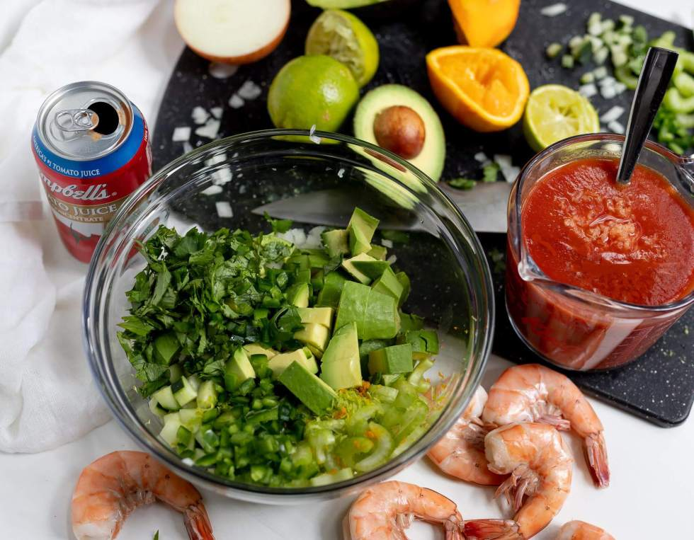 ingredients for mexican shrimp cocktail while being prepared