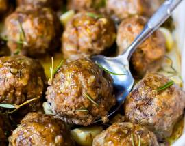 pan of whole 30 meatballs with a serving spoon