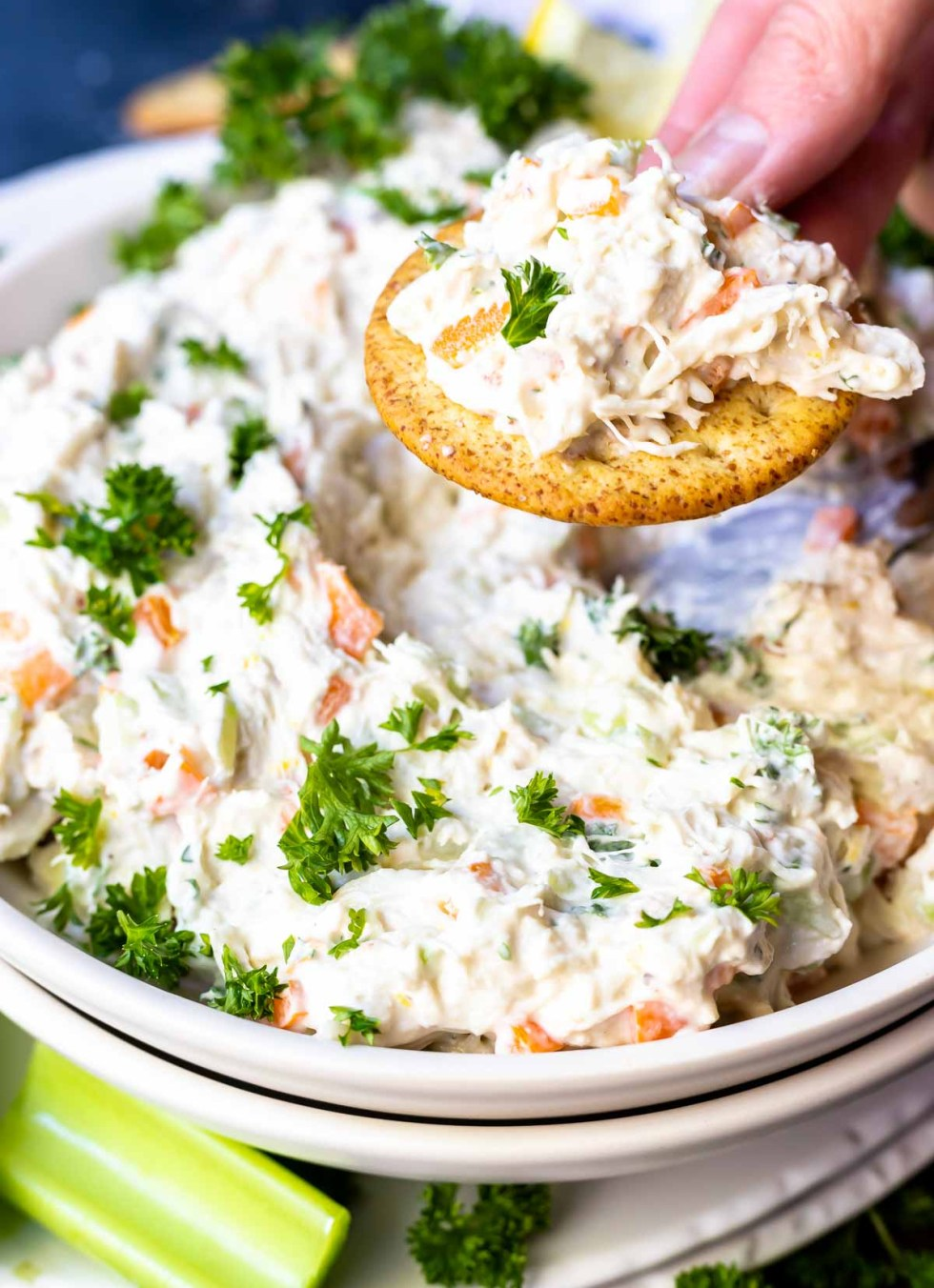 cold crab dip on top of a cracker