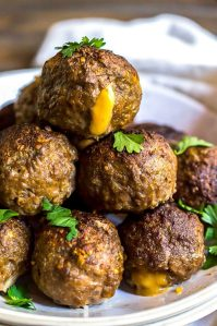 cheese stuffed meatballs on white platter