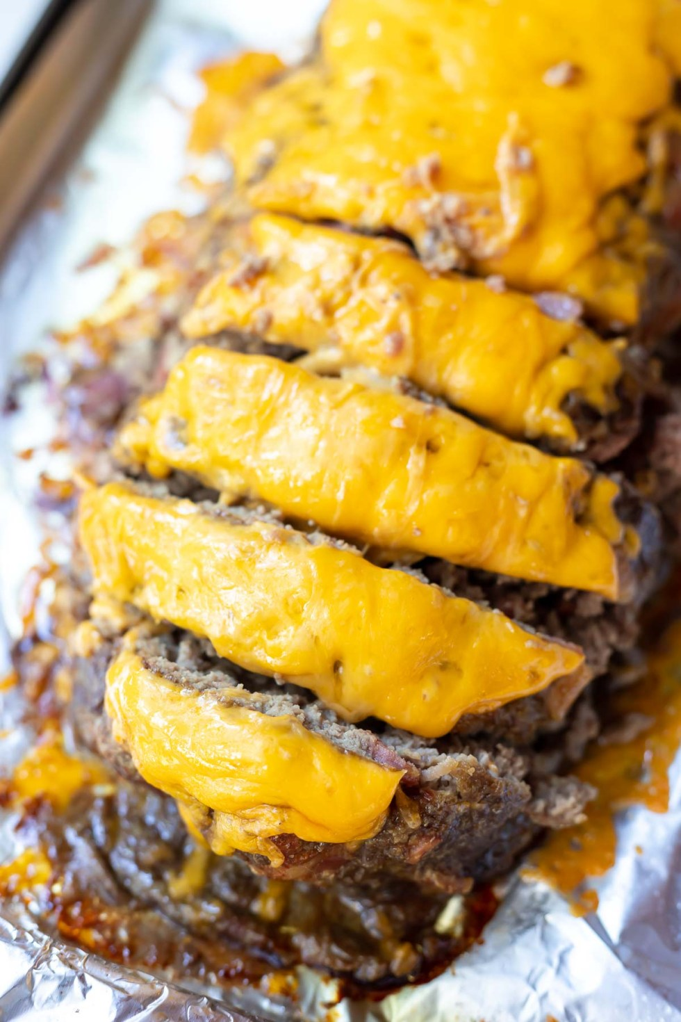 cheeseburger meatloaf sliced and ready to serve