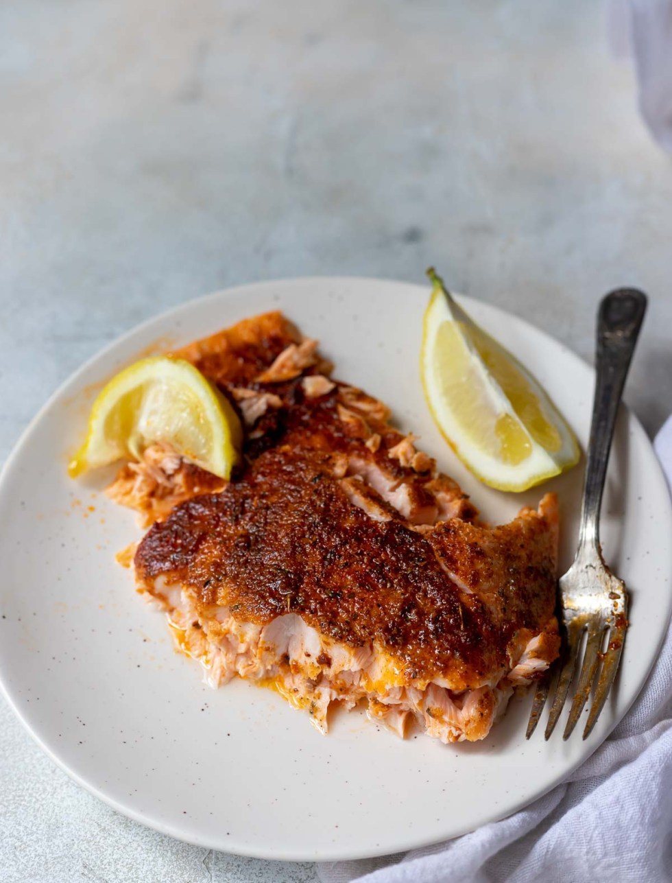 oven baked blackened salmon served on white plate