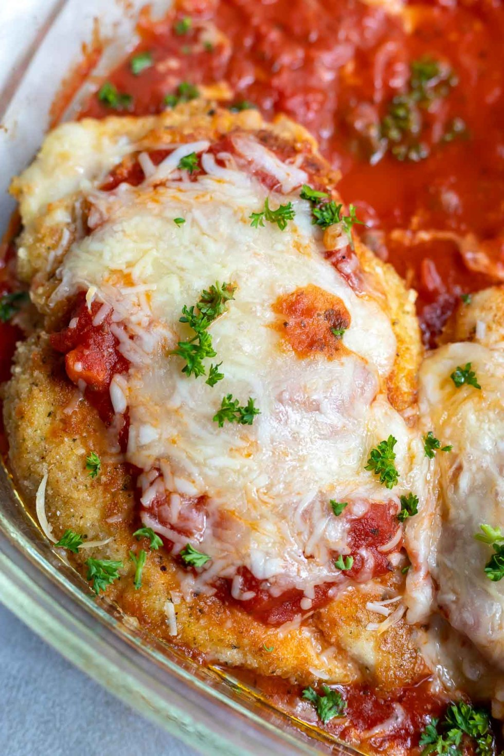 golden fried chicken farm topped with marinara and melted mozzarella cheese