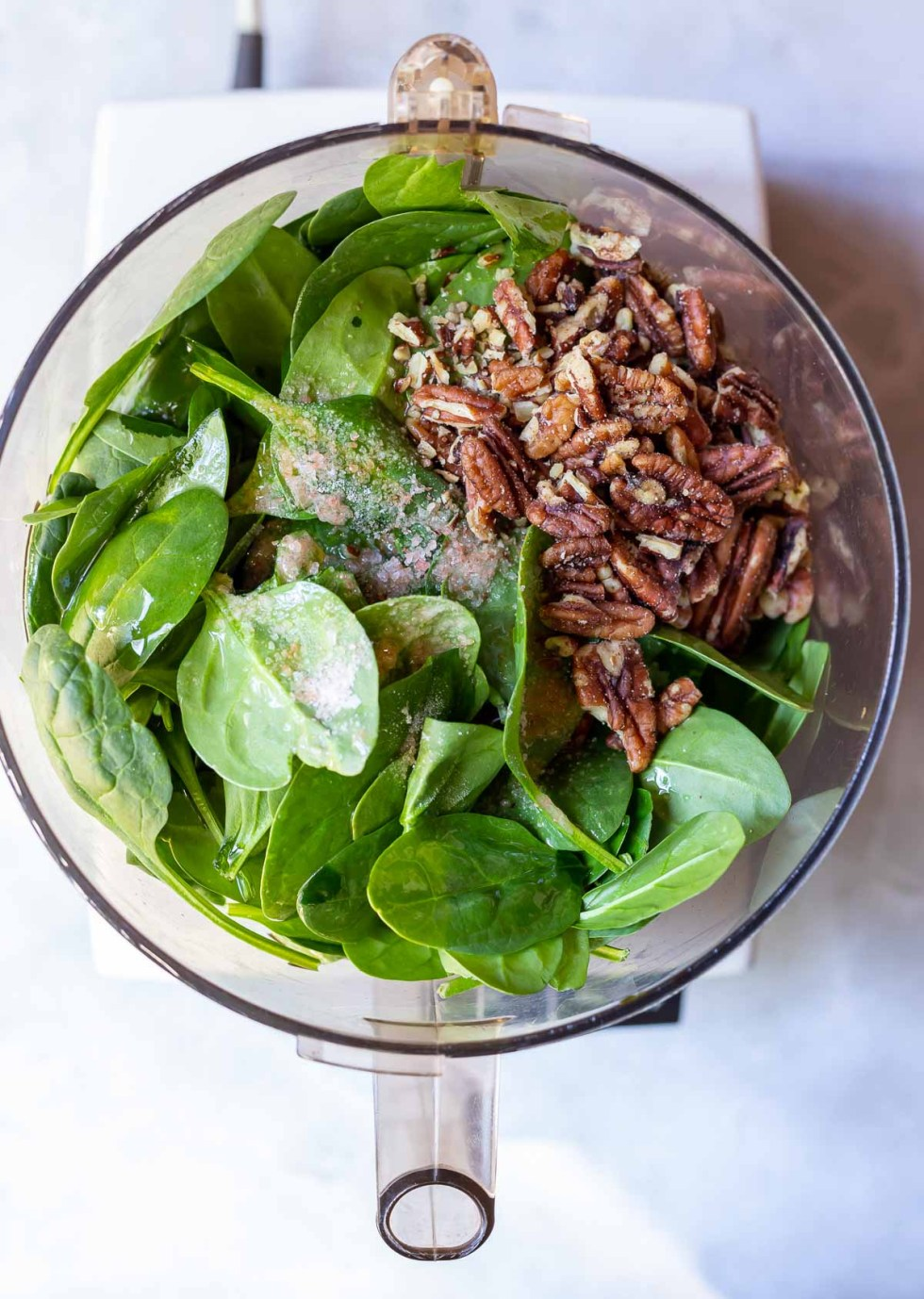 spinach pesto ingredients in food processor