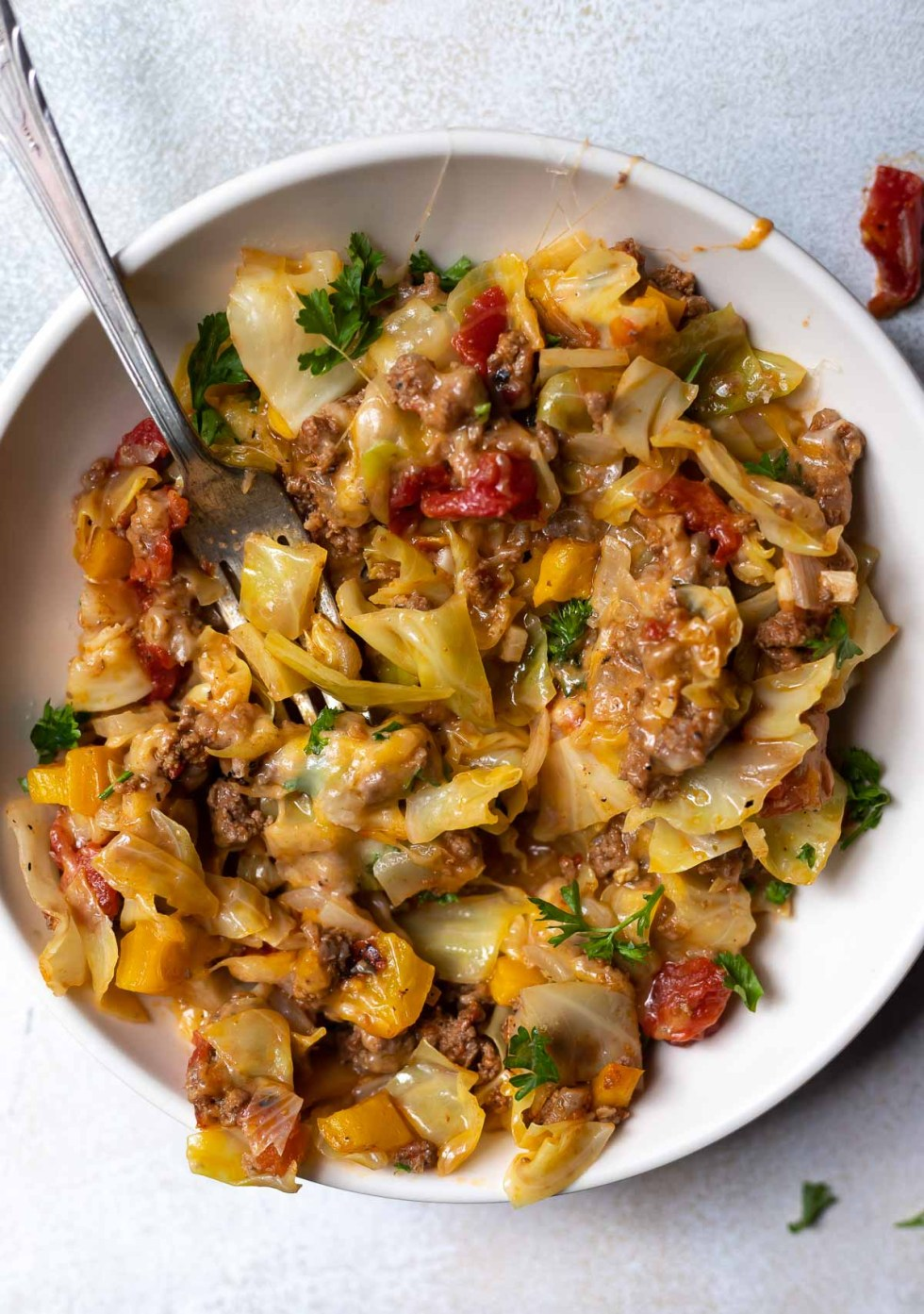 unstuffed cabbage casserole served in white bowl with silver fork
