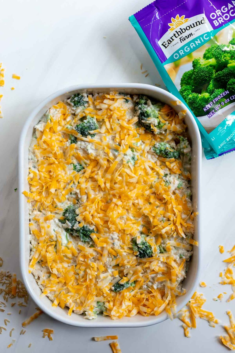 broccoli cheese rice casserole in casserole dish ready to be baked