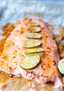 salmon fillet topped with chilis and sliced limes