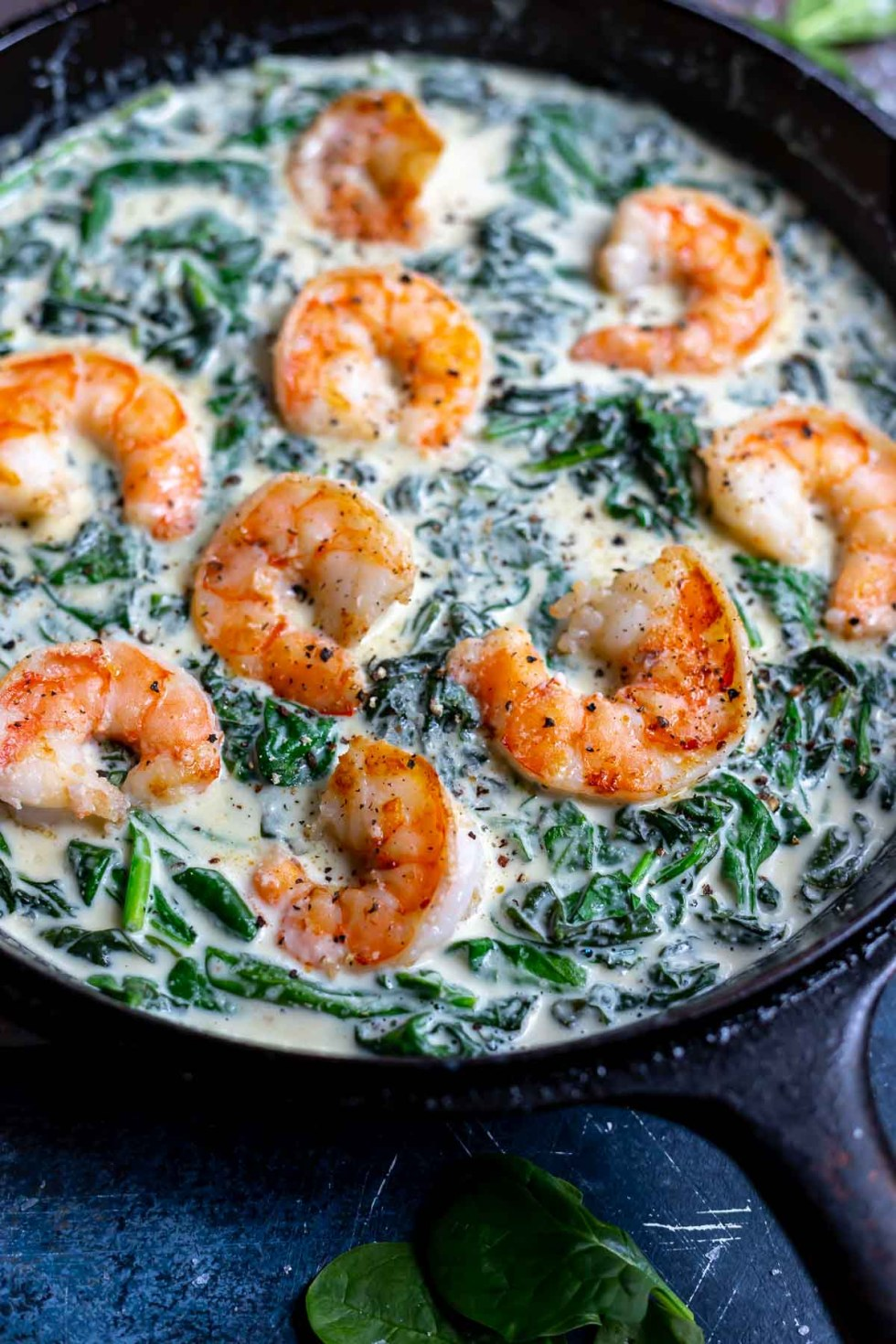 pink cooked shrimp in creamy spinach sauce