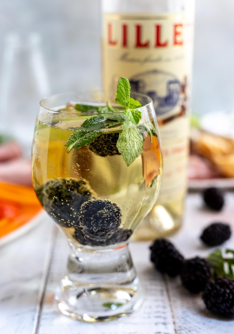 white wine spritzer with blackberries and mint