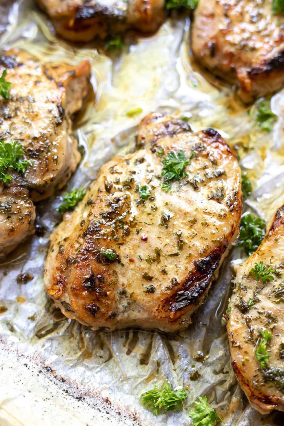 pork chops on baking sheet
