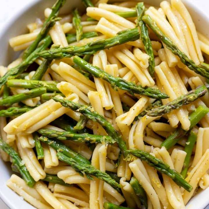 asparagus and pasta in white bowl