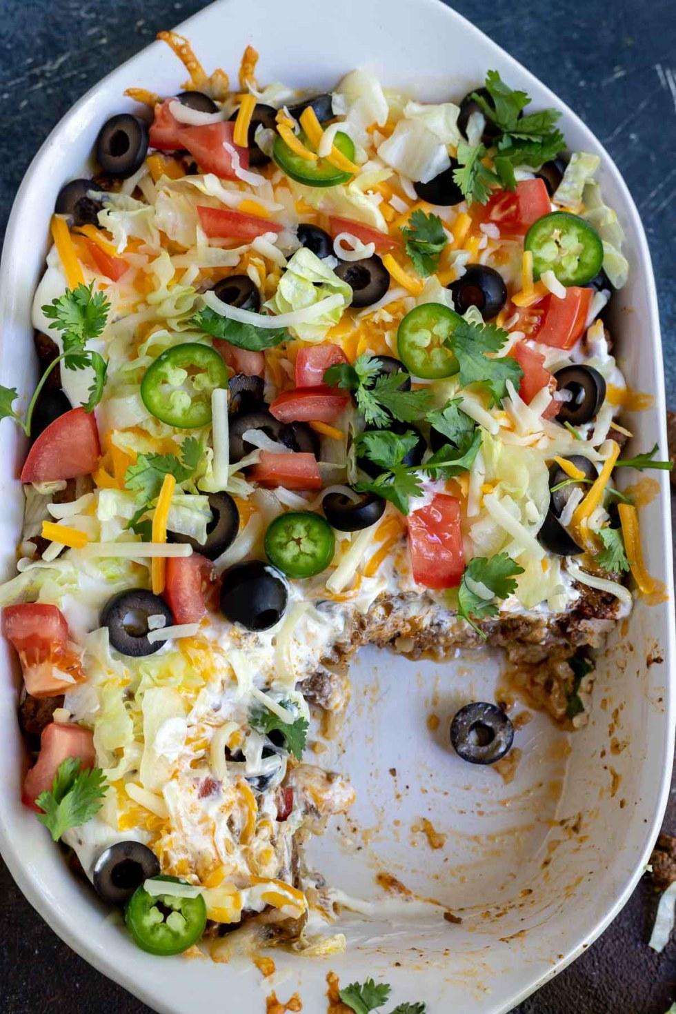 taco casserole in white dish