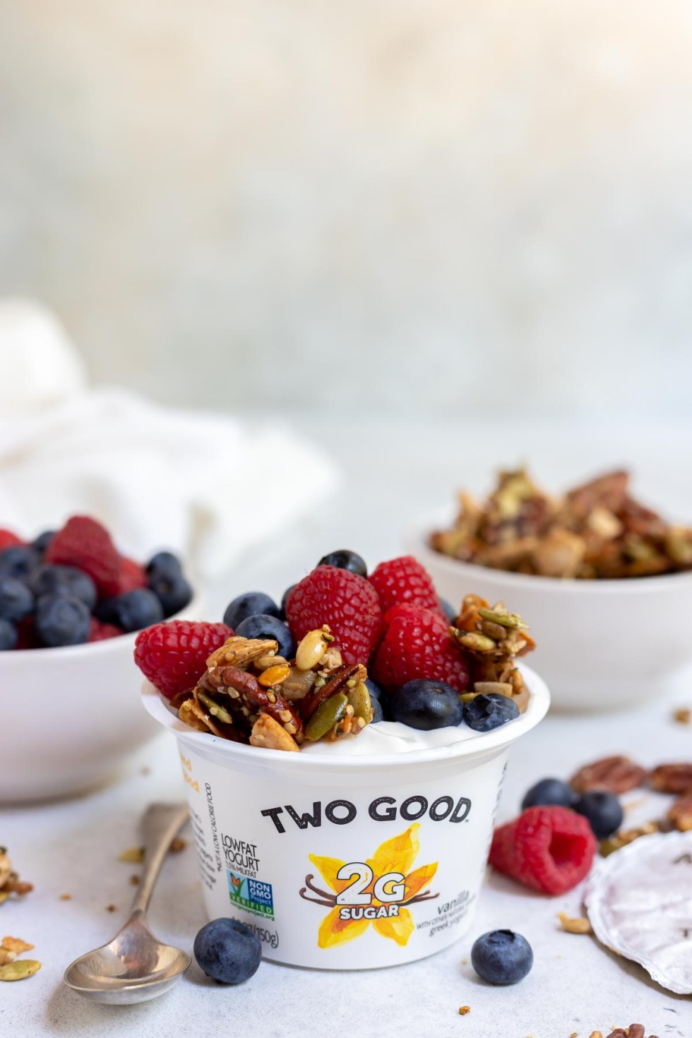 yogurt topped with granola and berries
