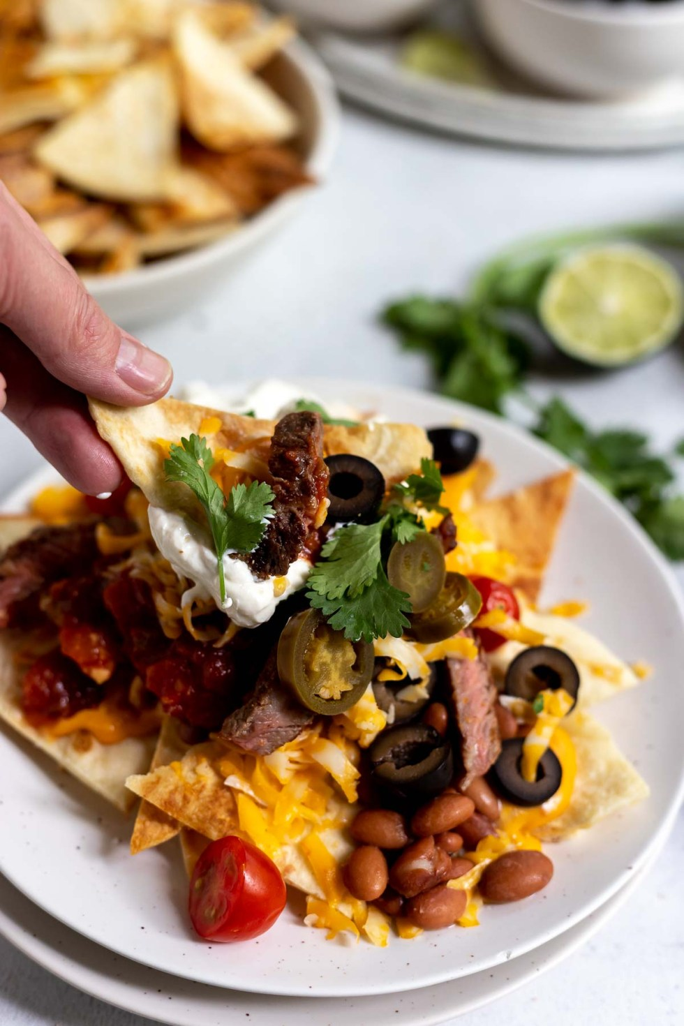 homemade tortilla chips topped with nacho toppings
