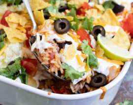 serving spoon scooping taco casserole out of dish