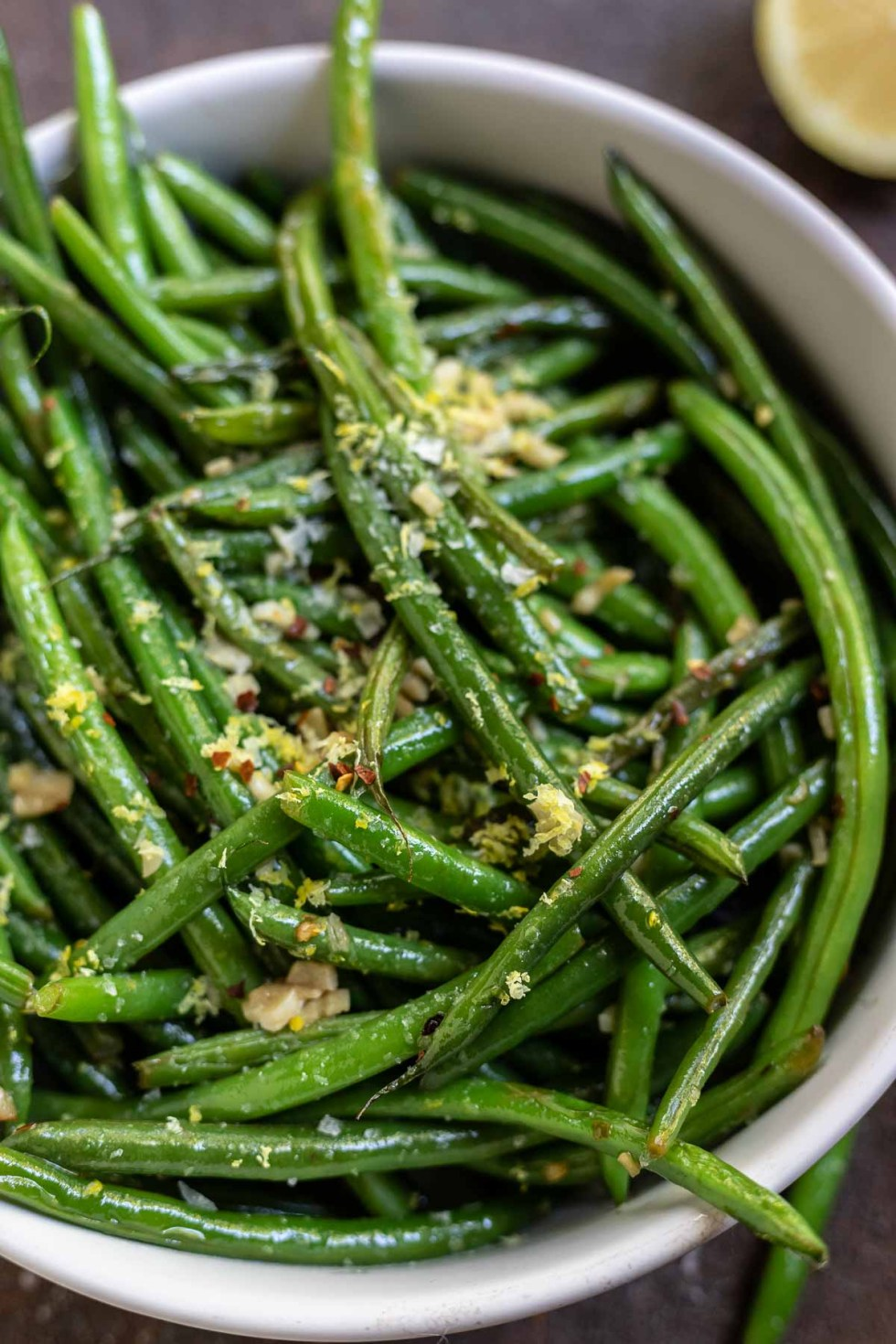 green beans topped with flaked salt and lemon zest