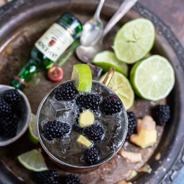 blackberry mule with limes and whiskey