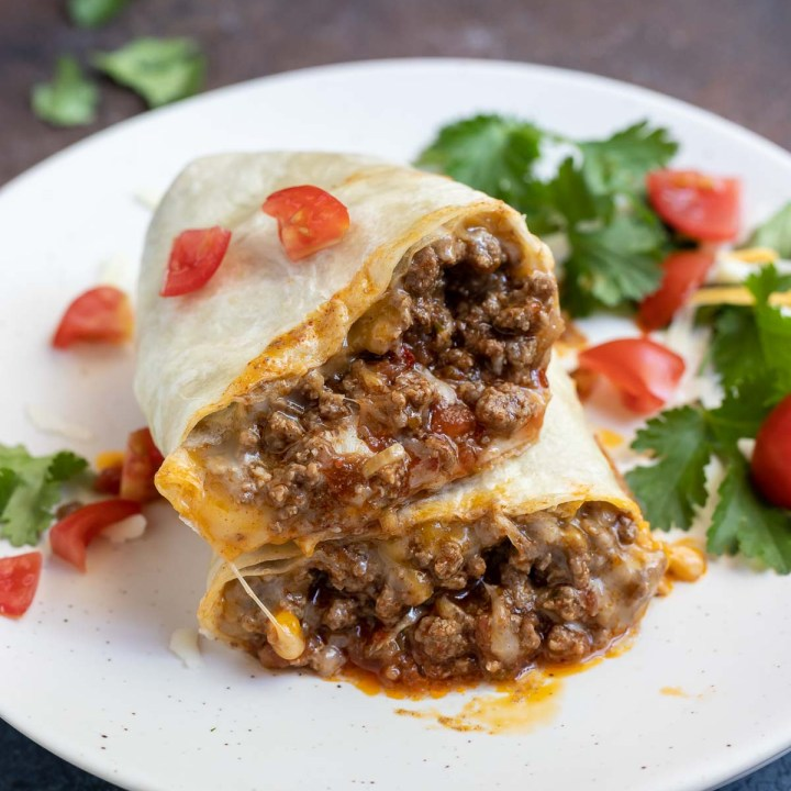taco cut in half to show meat and cheese on the inside