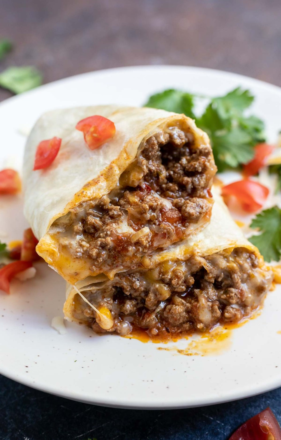 saucy ground beef and melty cheese rolled into flour tortillas