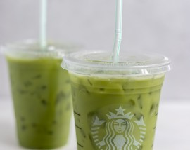 bright green drink in clear plastic cups with straws