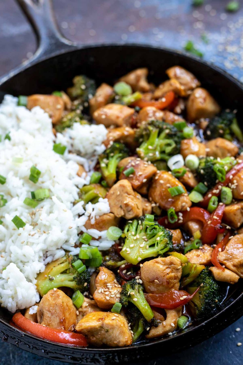 chicken teriyaki and broccoli in cast iron pan