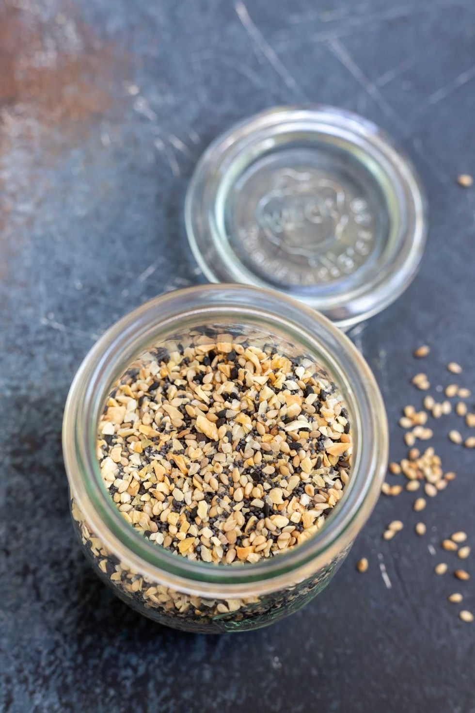 spice blend in clear glass jar with glass lid next to it