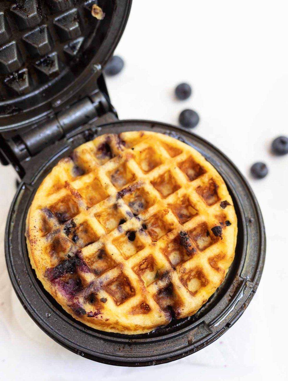 blueberry waffle in waffle iron