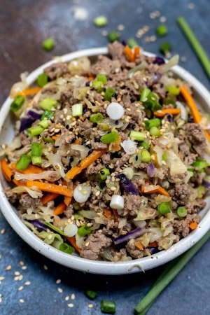 prepared meat and vegetables in white bowl