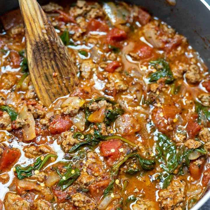 prepared tomato pasta sauce in pot with wooden spoon