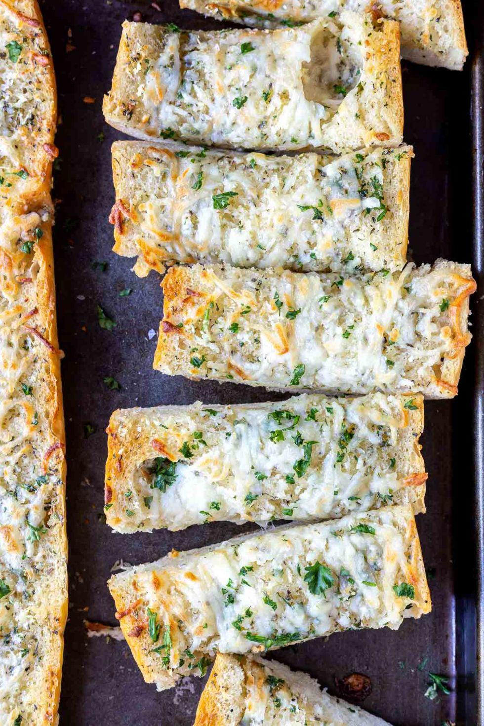 sliced baked garlic bread on baking sheet