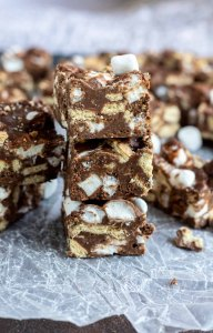 fudge squares stacked on wax paper
