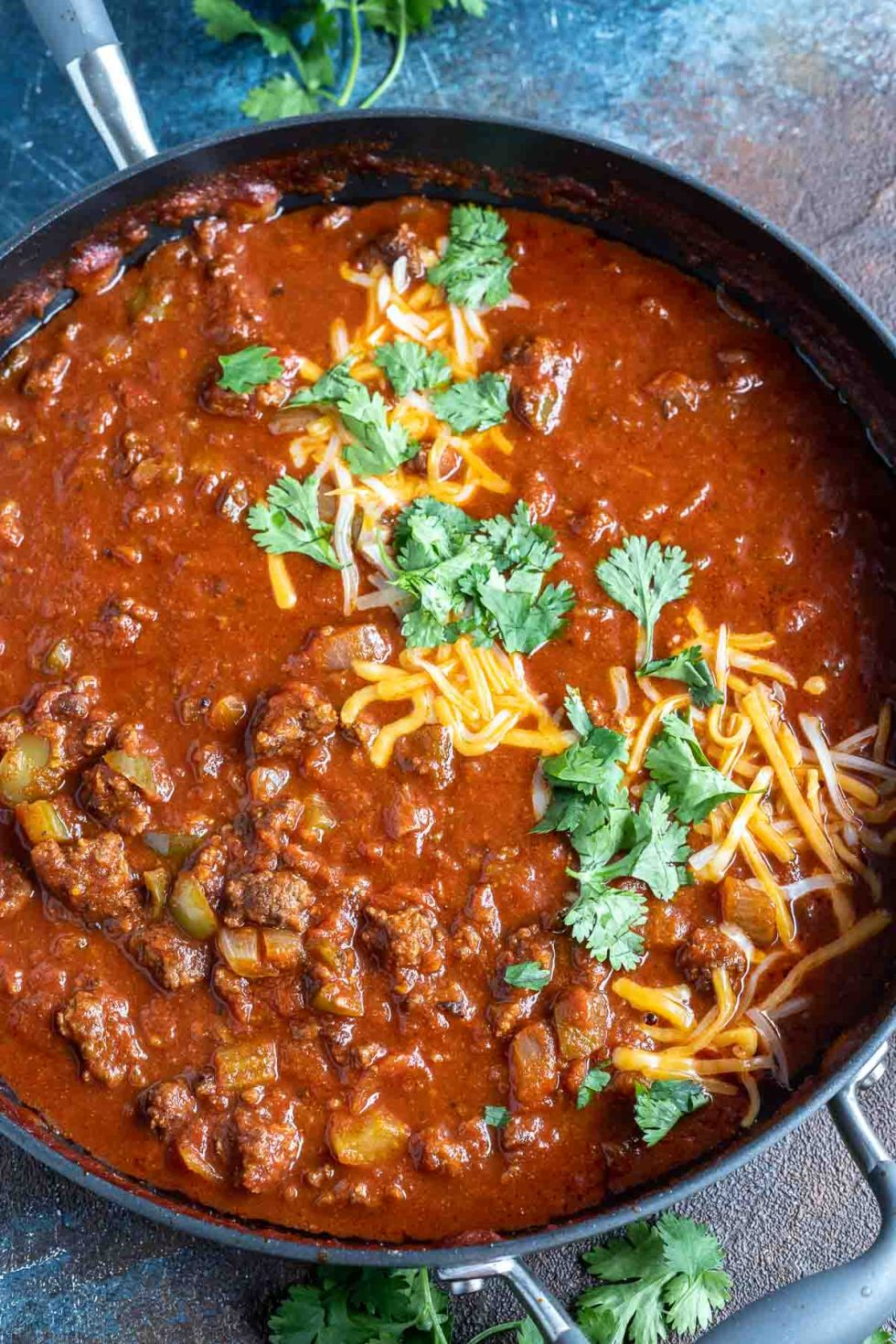 meat chili in pan topped with cheese