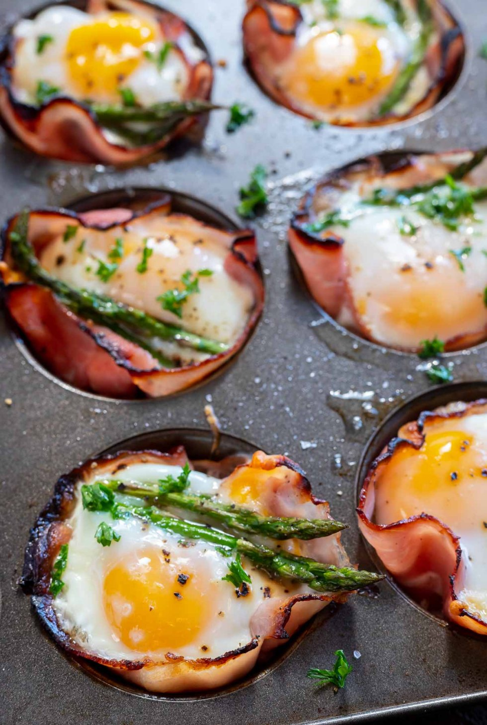 cooked ham egg cups in muffin tin