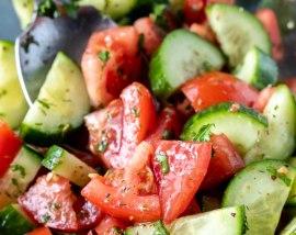 prepared cucumber salad in glass bowl