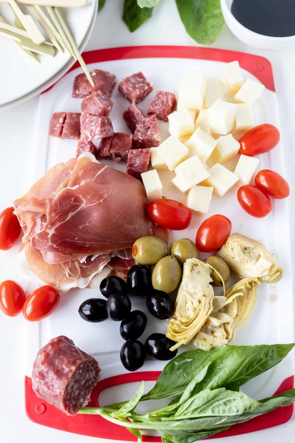 ingredients for antipasto appetizer skewers on cutting board