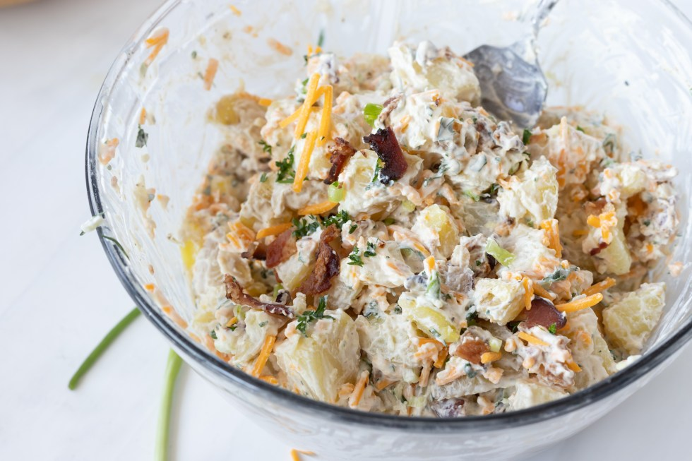mixed potato salad in glass bowl
