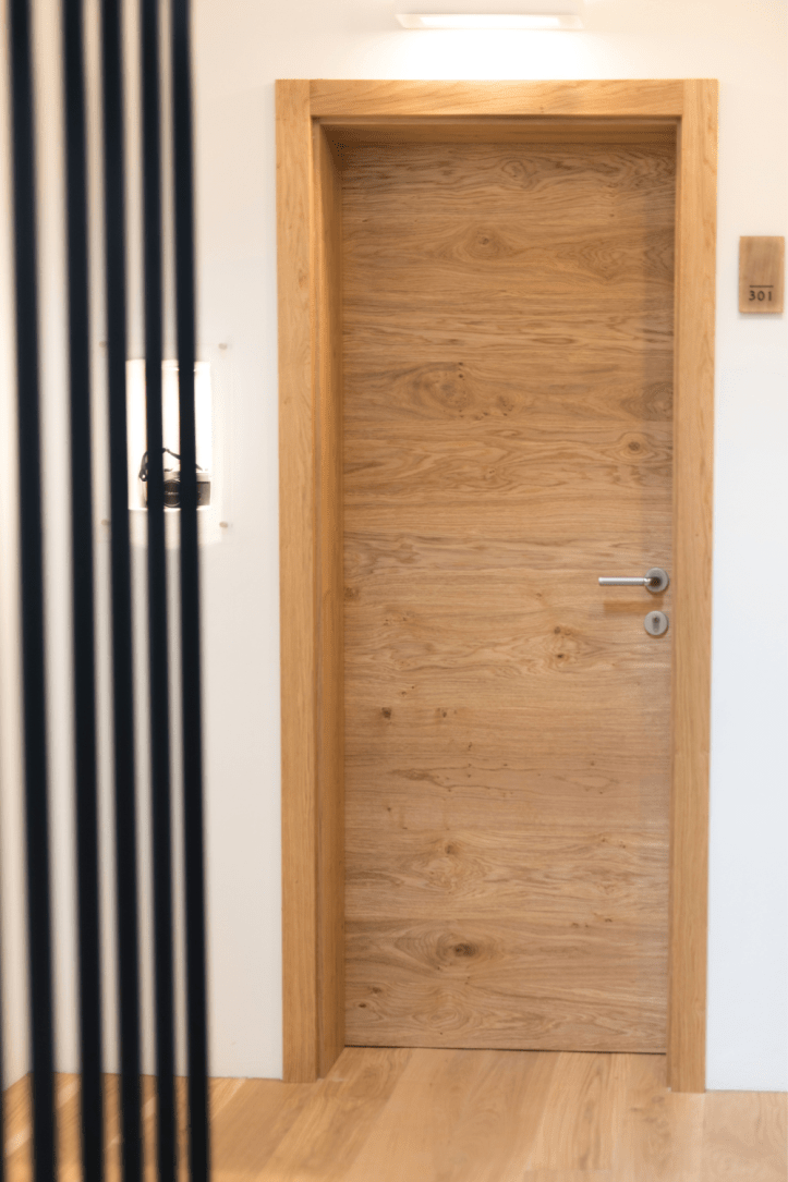 Is it possible to drill or paint a fire door within a rental property?