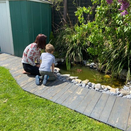 enjoying the garden pond