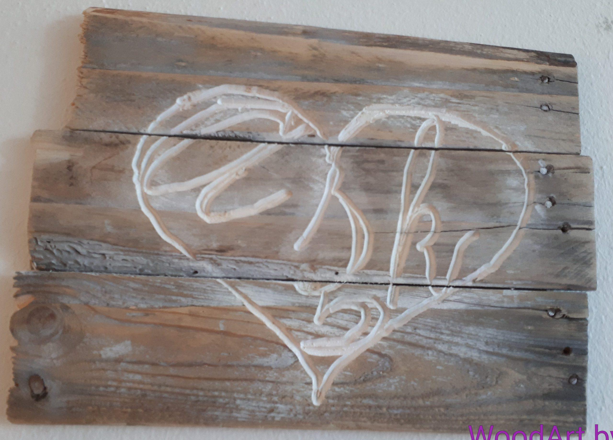 Schnitzerei Herz auf Altholz in türkisch