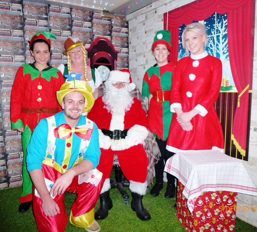 Santa and his team of Elves in Santa Land