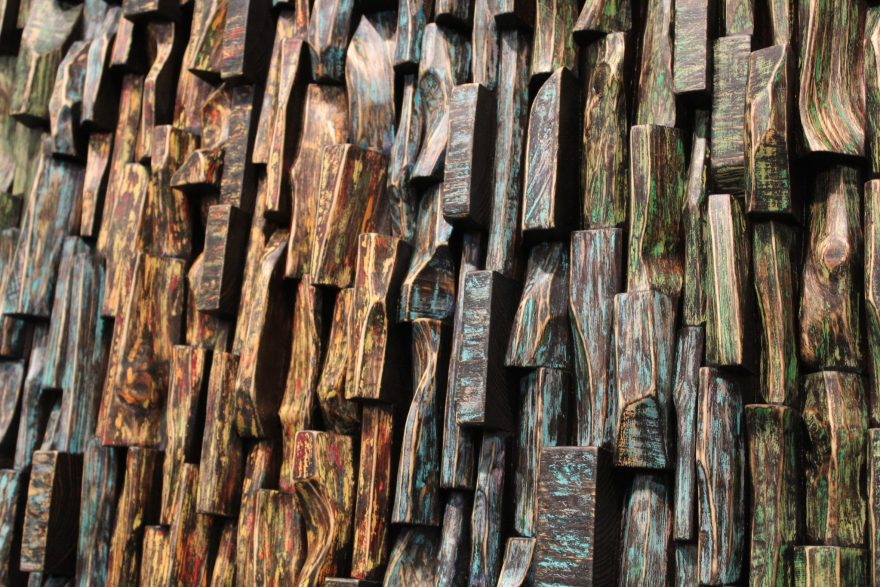 Wood collage sculpture with a uniquely textured surface and intricate wood blocks shapes by Canadian artist Olga Oreshyna